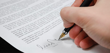 Covering letter - Someone signing a letter with a fountain pen